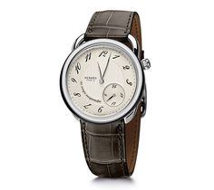 "Arceau Hermes steel watch, diameter 38mm, opaline silvered dial, automatic movement, ""suspended time"" module, short interchangeable smooth elephant grey alligator leather strap"