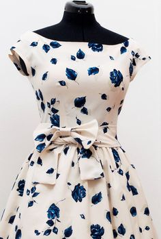 50s party dress/ 50s prom dress/ 50s cupcake dress/ mad men dress/ white floral pinup tea party dress MADE TO ORDER. $118.00, via Etsy.
