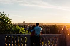 A cute couple enjoys the view as the sun sets in Rome, Italy | Erin + Paul's couples session in Rome, Italy by Honey and the Moon Photography #romantic #weddingphotographer