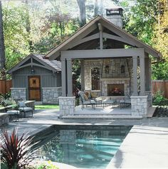 Outdoor room with fireplace, Pool and garden shed close up