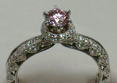 intricate pink diamond ring. I'm sure this is an estate ring. I think it's absolutely fabulous :)