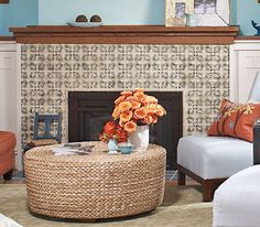 fireplace with a raised-leaf design  @Kelley McClain