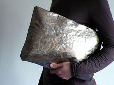 oversize silver / golden  zipper clutch. $45.00, via Etsy.