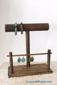 Wood jewelry display organizes your bracelets and earrings together. Shown here in ash stain. MEASUREMENTS: 11.5 inches long x 5.5 inches wide x 12.15 inches high - handcrafted in our workshop and stu