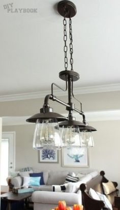 Dining Room Light Fixtures Lowes. Trio of industrial lights from  Lowe s over this wooden dining room table Maure Industrial Loft 4 Light Kitchen Island Pendant Chandelier