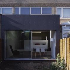 A lot of ex-council housing has a strong Modernist feel, all concrete and straight lines and big windows. So this sort of extension works really well with them.