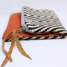 Handmade mini clutch made from upcycled fabric!