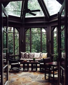 I love the slate floor, domed ceiling and tons of windows. It brings the outdoor inside.  see more patio ideas:  http://thegardeningcook.com/patios-of-the-day/