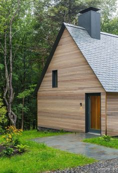 Timber Clad / Grey Powder Coated Chimney / Slate Pitched Roof / Woodland