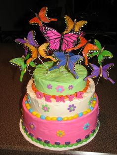 Butterfly cake....  tinted frosting and jelly beans.  The butterflies are not edible, found them in a craft store... glued them to white wire and coiled them.