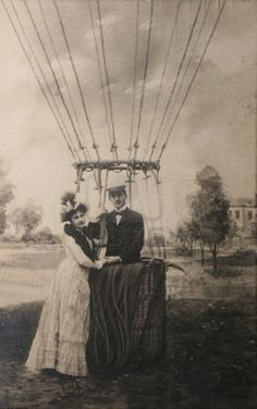 Vintage postcard from 1907 with loving couple near air balloon. Man standing proudly in basket, woman adoringly next to him.  Stock Photo