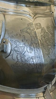 Closeup of modern inscription on Field Armor made in Nuremberg Germany 1540 CE with modern alterations including breastplate engraving (3)
