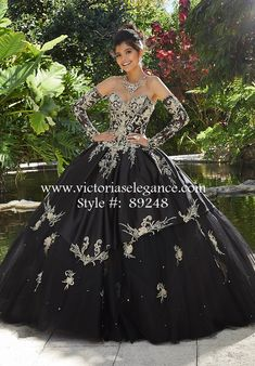 47c1edc8604 Dramatic tulle ball gown featuring rhinestone and crystal beading on  three-dimensional metallic embroidery