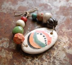 Modern Love… These hand formed ceramic beads and mid century pendant are glazed in shades of the earth and love. This set and its beads are an original copyright protected design. © 2015 Gaea Cannaday