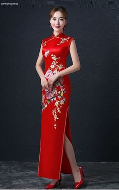 Color-rich wedding cheongsam flows with the sleek curve-conscious silhouette of this gown. Ornate beading dazzles the hips and front, and a plunging cowl detail