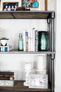 home tour of Amanda Holstein's san francisco studio apartment, home decor inspiration, coastal style, bright bohemian home design, bookshelf styling idea, Urban Outfitters bookshelf, wood and metal bookshelf, rustic bookshelf