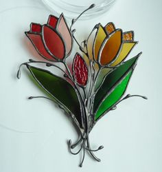 """Vintage Leaded Stained Glass Tulips. Sun Catcher. Hanging Sculpture. 8"""" x 6"""" Leaded and Welded Hand Cut Glass. Fine Craftsmanship. by VintageArtForLiving on Etsy https://www.etsy.com/listing/596494536/vintage-leaded-stained-glass-tulips-sun"""