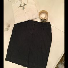 Dark blue skirt Dark blue chambray skirt. Has stretch to it and slit in back. It's made of a material that is similar to a very heavy chambray/ light Jean material with stretch LOFT Skirts