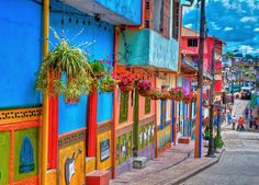 Guatape, Colombia: we visited this town in Aug. Really this pretty! The town is famous for the colorful murals on the bottom of each of the houses that tell a story. Visit Colombia, Colombia Travel, Travel Around The World, Around The Worlds, Travel Box, South America Travel, North America, What A Wonderful World, Viajes