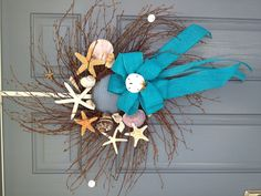 Seashell Wreath cute except bow....would change to burlap