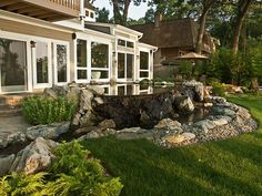 Amazing vanishing edge pond and more at this home in Huntington Station, NY. Gorgeous work by Deck and Patio Company.