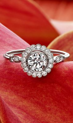 This romantic piece features a halo of shimmering diamond accents.