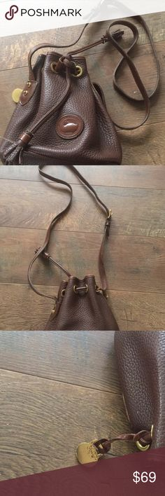 Vintage Dooney and Bourke Mini Purse Looks as sweet as chocolate. This purse is authentic and gently worn. Have fun running those errands or going to work with this light purse. It is somewhat bent out of shape due to storage. One items are placed in, shouldn't be a problem. Dooney & Bourke Bags Mini Bags