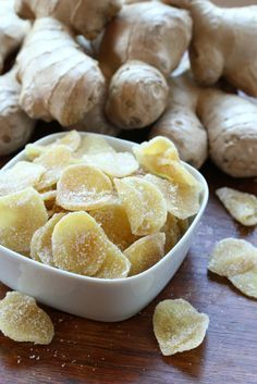 how to make homemade crystallized ginger recipe 1 pound peeled and sliced ginger, preferably young/smaller roots, sliced about ⅛ inch thick (by hand or use a mandolin) Pinch of salt 2 cups white granulated sugar Extra sugar for coating Crystalized Ginger Recipe, Ginger Candy Recipe, Recipes With Ginger Root, Salsa Dulce, Ginger Slice, Dehydrator Recipes, Homemade Candies, Candy Recipes, Gourmet
