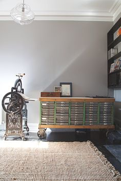 """The spare room/office.                                                                                                        Printing Press and drawer unit:  """"An antique mangle repurposed by Adelaide printmaker Julie Corfe. It was bought by her family from England in the 1800s. Rock n Rustic - Adelaide. We didn't have a vehicle big enough to transport it, and they didn't deliver – we rolled it along the foot path for the whole 2 kilometers home!"""""""