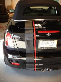Custom gray carbon fiber and red accent racing stripes on black MINI Roadster