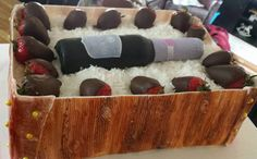 wine bottle with chocolate covered strawberries in a box cake