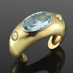 Yellow Gold and Aquamarine Cuff Bracelet by Rene Boivin, circa 1940  MY BIRTHSTONE I REALLY NEEED THIS