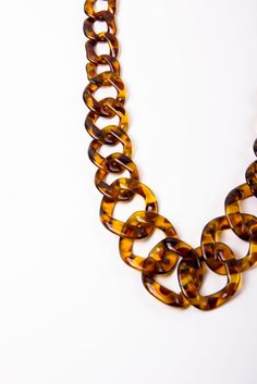 Loving the tortoise shell! Especially since this style or necklace usually comes in silver or gold...