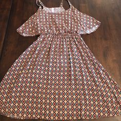 Print dress Size medium Target dress! In great condition! No stains or tears! Has an elastic waste, and a cute ruffle top! Xhilaration Dresses