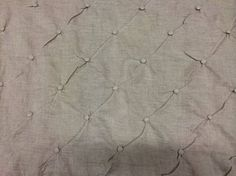 100% lino lavorato con motivo geometrico a quadri intervallati da bottoni tono su tono. #Collezione #Purity #Tessuto #Teodora  #tessuti #tendeperlacasa #interiordesign #textiles #cta  www.ctasrl.com