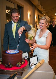 Cutting the baseball themed wedding cake -  Texas Rangers.  Love it!  #baseballwedding