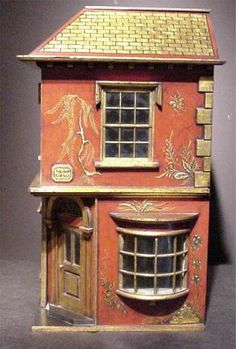 this ceramic house looks like one I used to have by the fireplace for Christmas only I didn't paint in this style