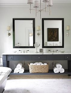 dark vanity, white walls
