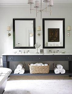 chandelier, dark vanity, white walls