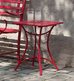 Small Red Metal Side Table for between your two porch chairs. 17x17x22h