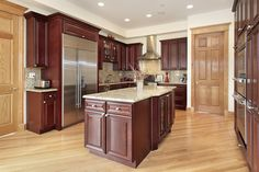 Kitchen with cherry wood cabinets and light color tan granite, and interesting mosaic back-splash.