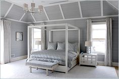 This truly is a dreamy bedroom!  Grey and White done Right!