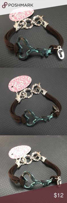 NWT Heart Key Bracelet This has the tags attached and is a great piece! It's a rustic and teal color and has two loops for adjustable fitting. Jewelry Bracelets