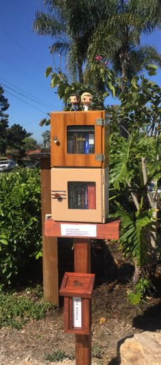Tamara Smith. Bonita, CA.  I made my Library from two old barbershop sterilizers that I happened to have on hand. I change out the literary figures on top as I come across new ones. This month it is 'Pride and Prejudice and Zombies!'