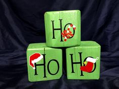 3 x 3 x 3 Wooden Green Blocks with Black HO HO HO vinyl lettering. Each block has a different Christmas item - Stocking, Candy Cane and Santa Hat. Wooden Christmas Crafts, Halloween Wood Crafts, Christmas Blocks, Pallet Christmas Tree, Small Christmas Trees, Holiday Crafts For Kids, Christmas Ornament Crafts, Green Christmas, Xmas Crafts