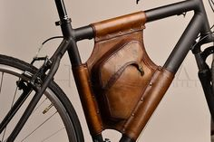 Most stylish frame bag I've seen so far:  Handmade Leather Bicycle Bag by StudioImpossibilis on Etsy, €220.00