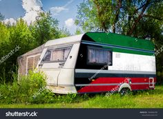 A car trailer, a motor home, painted in the national flag of Kuwait stands parked in a mountainous. Trailers, Car Trailer, En Stock, National Flag, House Painting, Motorhome, Recreational Vehicles, Photo Editing, Royalty Free Stock Photos