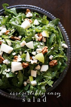 Easy fall fresh salad - pears, blue cheese & walnuts tossed in a homemade white wine vinaigrette in less than 5 minutes start to finish