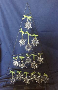 """My Swarovski snowflake ornaments...have one for every year since we got married (2000-2014). Finally found a """"tree"""" to display them all"""