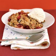 Bake this pecan-topped apple crisp on a brisk autumn day. Bright red cranberries bestow a pleasing tartness.